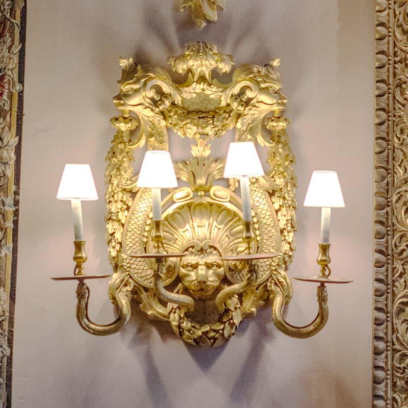 Detail of a set of six George II giltwood wall-lights