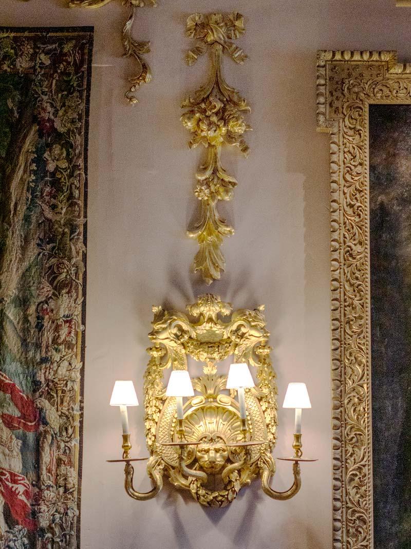 A set of six George II giltwood wall-lights