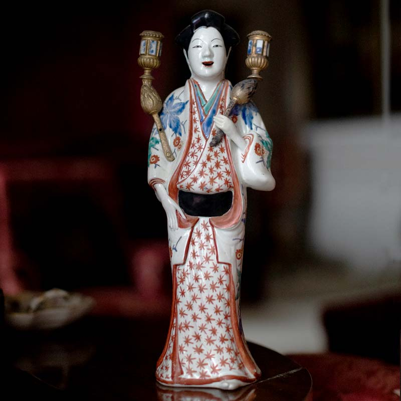 Detail of a Japanese Kakiemon bijin (or beautiful lady) of the Edo Period