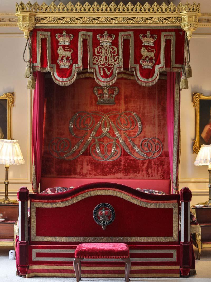 The crimson velvet lambrequin pelmet and backboard