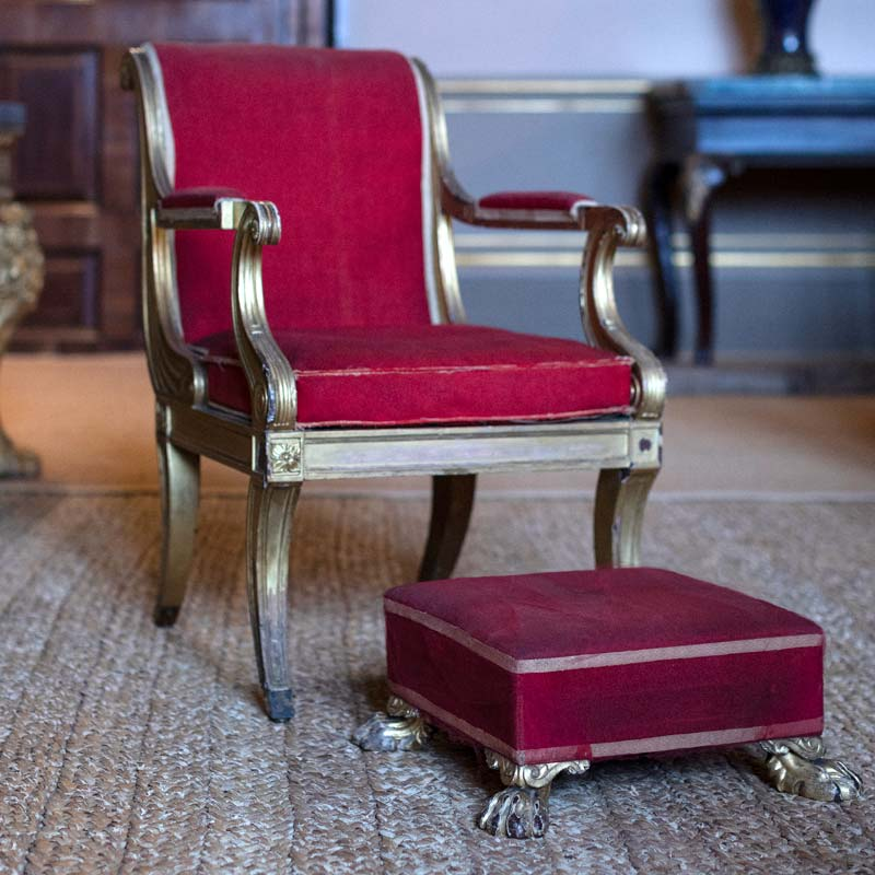 Detail of A Regency gilded mahogany open armchair and footstool supplied by Russell, Valance & Evans